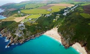 Ariel view of the cliffs and coastline of Cornwall, including the Minack theatre.