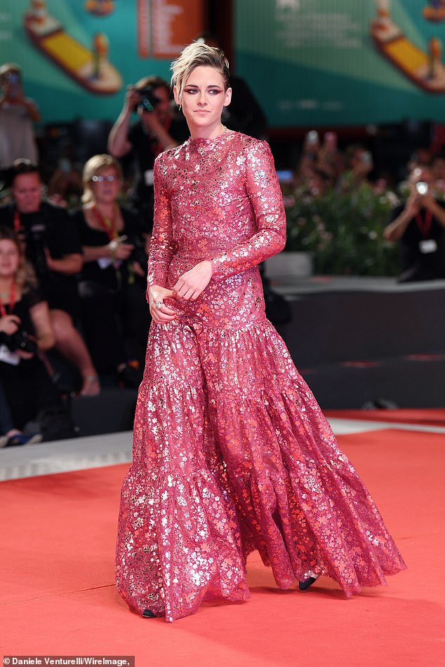 Wow:Kristen's low-key look comes a day after she stunned crowds in a red lace gown with a high neck and dramatic ruffled skirt as she arrived for the launch of her newest film Seberg.