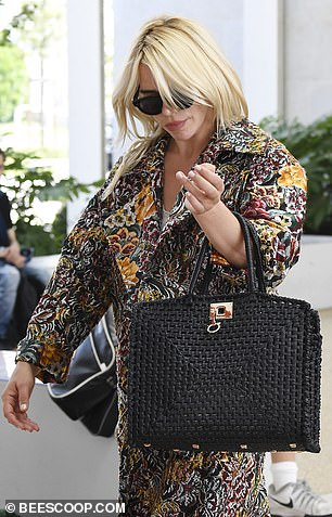 Making her exit: Billie commanded attention in her stylish ensemble as she left her hotel