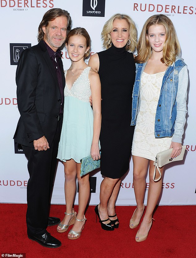 Operation Varsity Blues:Felicity admitted to shelling out $15,000 for a proctor to correct wrong answers on her daughter Sofia SATs (L-RWilliam H. Macy, Georgia Macy, Felicity Huffman and Sofia Macy in 2014)