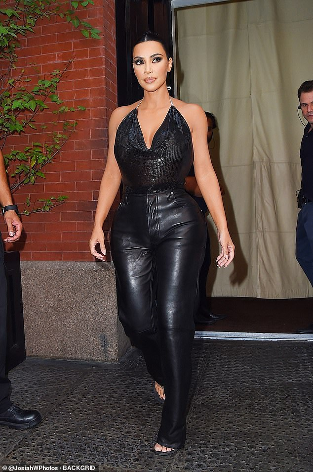Heels to you!Kim tied her look together with her new signature footwear style: a pair of thong sandals with heels