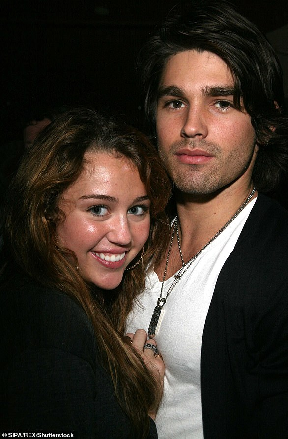 Lovebirds: She had a nine-month romance with underwear model Justin Gaston, who competed on Nashville Star, a show presented by her father Billy Ray Cyrus