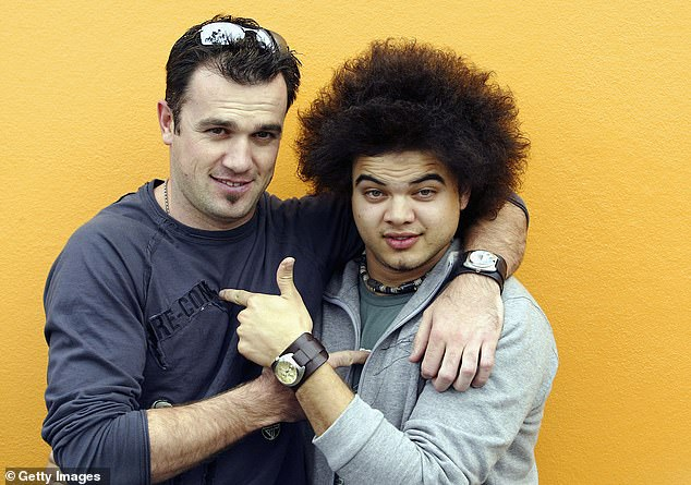 Gracious: Guy told The Daily Telegraph that own experience of being roasted at an awards ceremony taught him the importance of showing kindness to other artists. Pictured with Shannon Noll (left) during their Australian Idol days
