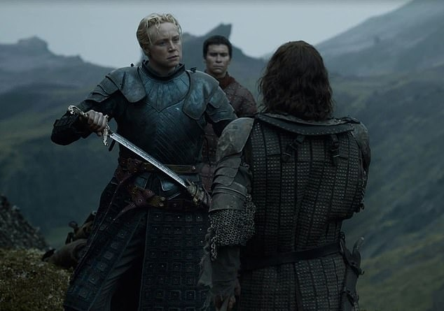 Throwback: She has let her signature blonde hair grow into long waves that are a far cry from the close-cropped do she wore as Brienne Of Tarth on Game Of Thrones (pictured)