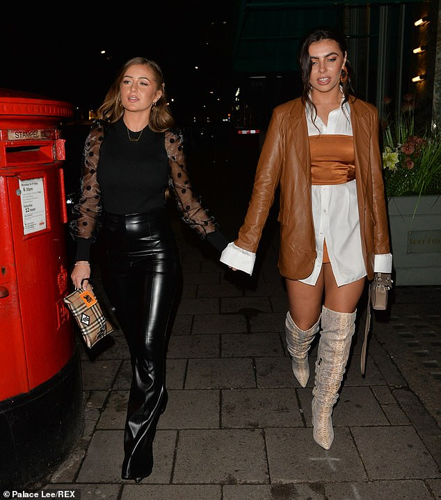 All about the accessories:Francesca completed the look with a mini taupe handbag whilst she wore her glossy curly locks swept back to expose a pair of red hooped earrings