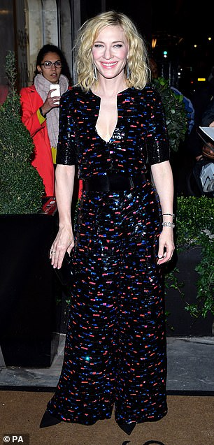 Busty: Cate flashed a hint of cleavage in the black printed jumpsuit with a red and blue print