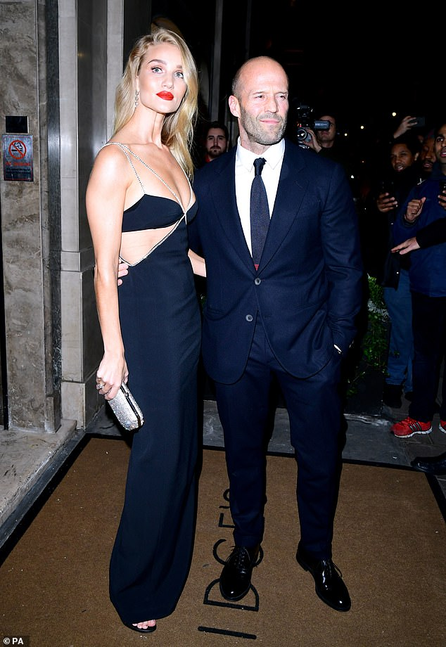Amazing:Also among the guests in attendance was Rosie Huntington-Whiteley, who put on a racy display in a stunning black gown as she cosied up to her fiancé Jason Statham.