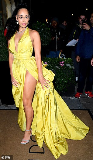 She's here! The singer arrived for the occasion in abanana yellow gown with a thigh-high split