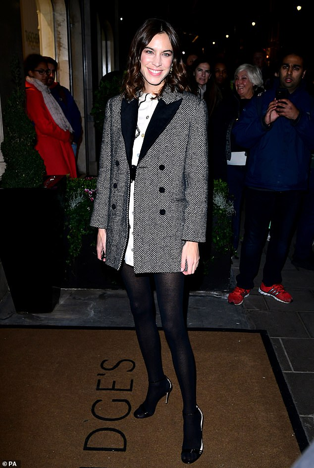 Cosy: Alexa Chung, 35, was wrapped up against the chilly weather in a grey tweed coat over a cream shirt dress