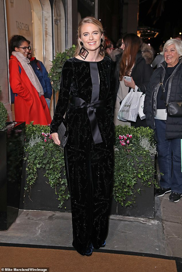 Jaw-dropping:Fellow fashion favourite Cressida Bonas, 30, amped up the glamour in a sparkling black velvet jumpsuit with a bow satin trim as she arrived for the bash