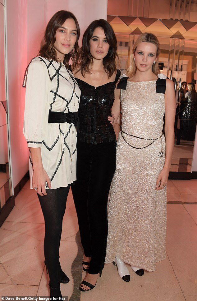 Simple: Alexa still highlighted her slender pins in the dress which she teamed with simple black tights (pictured with Gala and actress Greta Bellamacina)