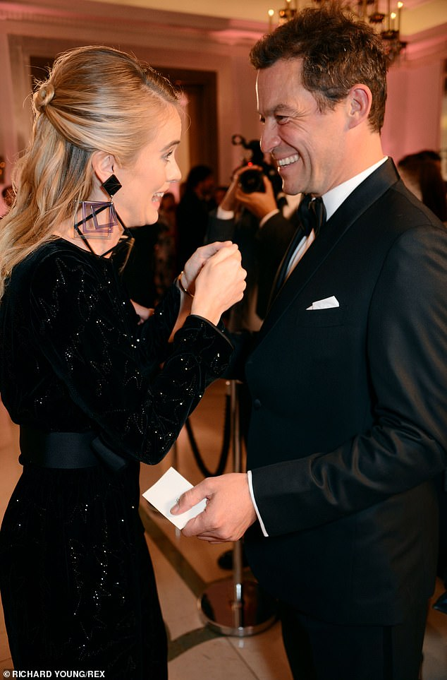 Friendly: Inside the awards show Cressida laughted along with actor Dominic West as they chatted ahead of the occaison