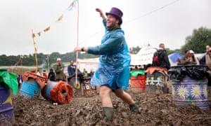 Revellers battle the mud at Glastonbury 2016.