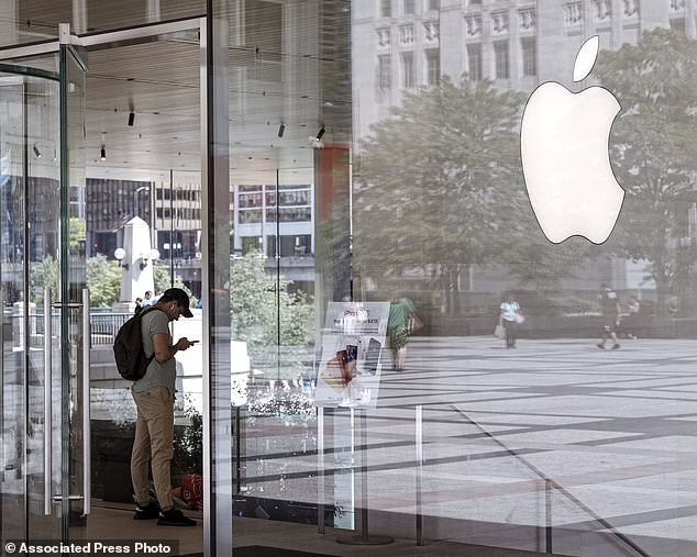 FILE - This July 24, 2019, file photo shows an Apple Store in Chicago is seen. Apple Inc. reports financial earns on Wednesday, Oct. 30. (AP Photo/Amr Alfiky, File)