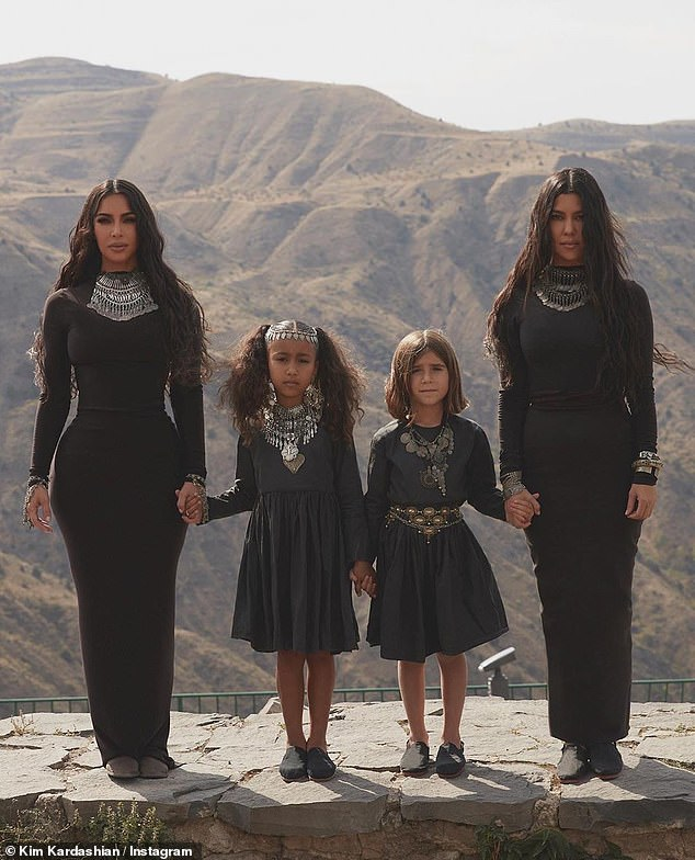 Ladies time: There was also another snap of the two sisters standing with Kim's oldest daughter, North, six, and Kourtney's daughter, Penelope, seven