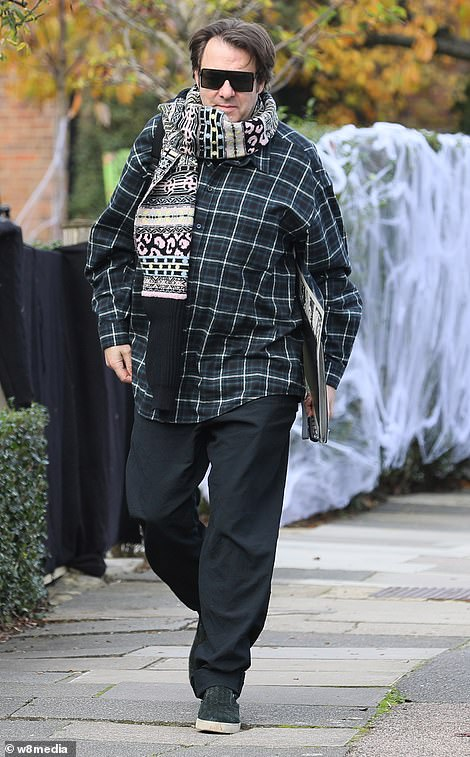 Ready to go: The TV presenter, 58, was also seen arriving home after a quick outing prior to the event, and he looked cosy as he wrapped up in a cosy ensemble
