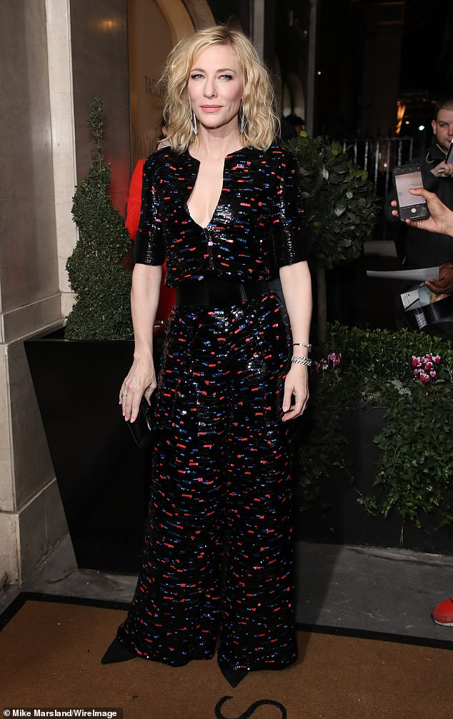 Amazing:Cate Blanchett, 50, displayed her elegant sense of style in a black printed jumpsuit as she led the star-studded arrivals at the Harper's Bazaar Women of The Year Awards