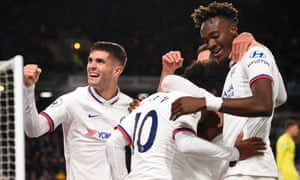 Willian celebrates scoring Chelsea's fourth goal with Tammy Abraham and Christian Pulisic at Burnley.