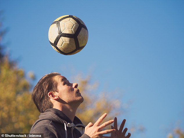 Each time a child guides the ball into the net with their head, it can cause microscopic injuries to the brain (stock image)