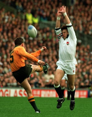 Simon Halliday attempts to take the ball from John Eagles