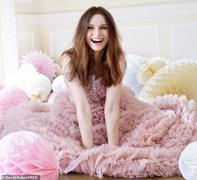 Candid: Sophie Ellis-Bextor, 40, has candidly spoken about struggling with 'guilt' as a wife and mother, as she graces the issue of Red magazine's December Issue
