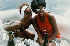 Whitney Houston and Robyn Crawford with bottle of champagne, on a boat, from the book A Song for You: My Life with Whitney Houston by Robyn Crawford