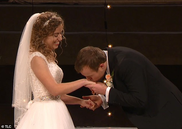 Not just yet! John fist kissed each of Abbie's hands, taking her by surprise and making the audience laugh