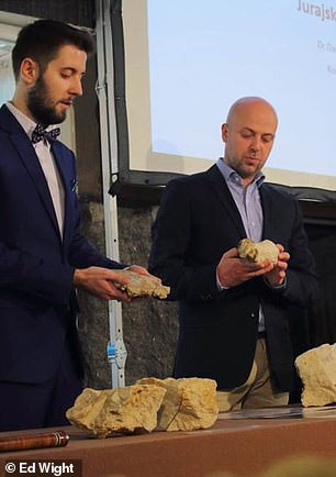 Palaeontologist Dr. Daniel Tyborowski (left) and Dr Błażej Błażejowski from from the Institute of Paleobiology explain the findings at a media conference