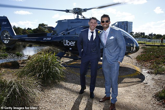 Stylish lads: Tim arrived at Flemington via an Uber helicopter with fellow reality star Lee Elliott