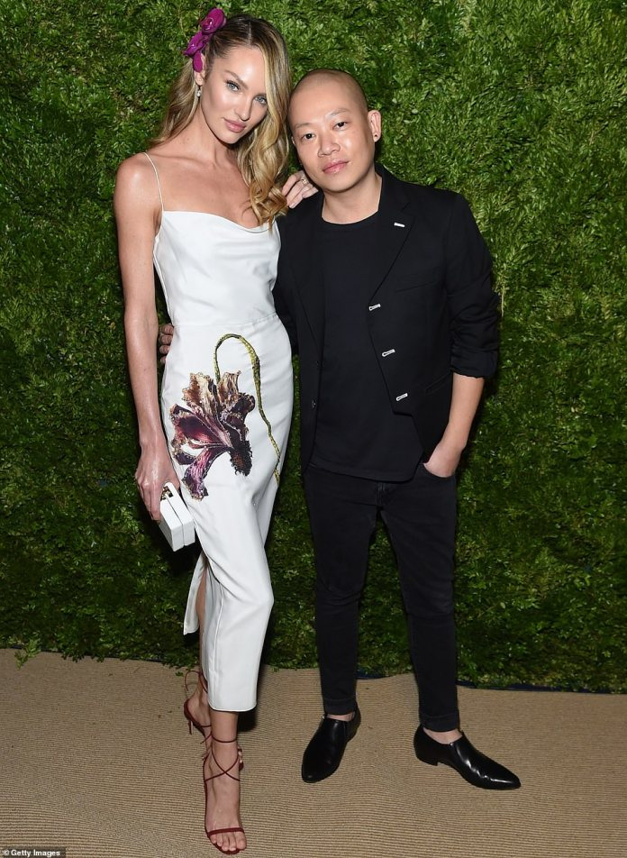 Contrasts: She posed with designer Jason Wu, most famous for creating multiple dresses for former First Lady Michelle Obama. He mixed classy and casual with a black blazer, black T-shirt and black jeans