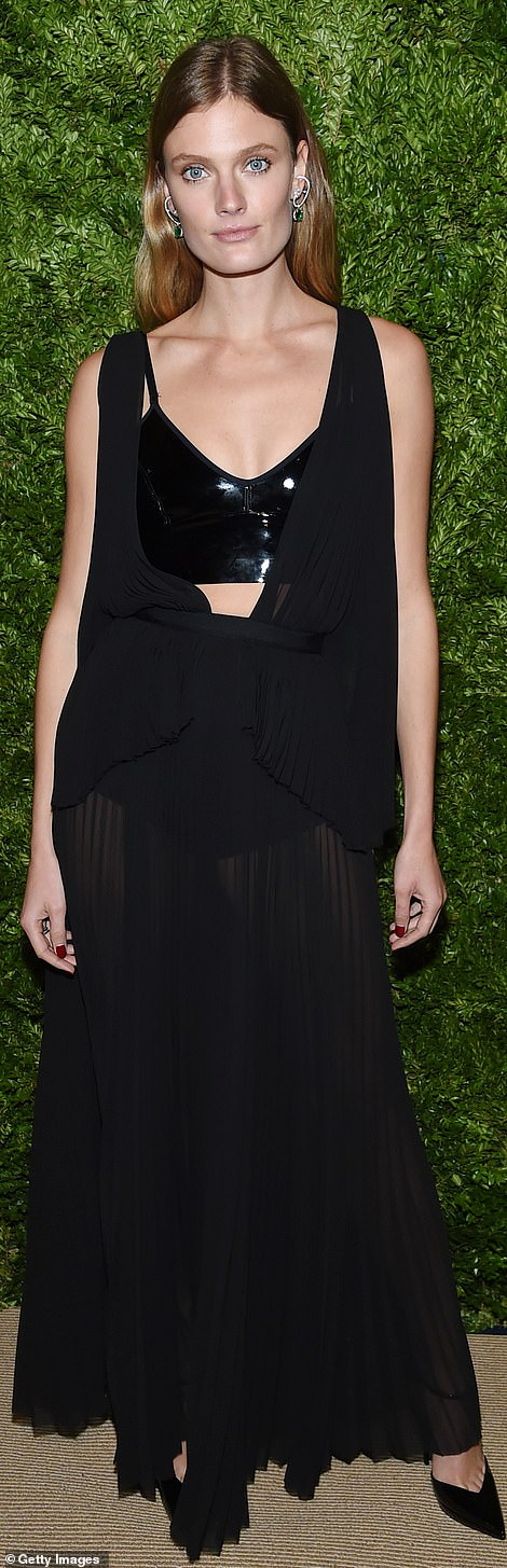 Revealing: Constance Jablonski looked like her polar opposite in a sheer black dress with a tightly pleated skirt and a leather bustier