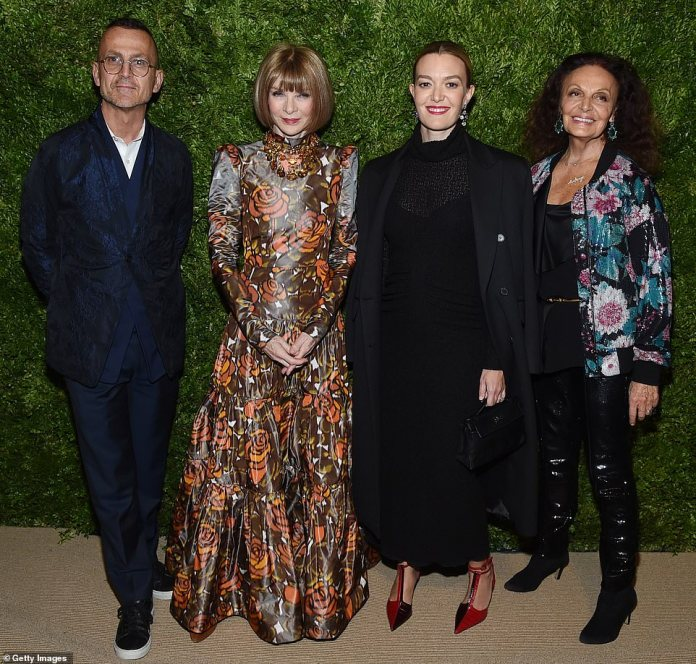 Blue mood: The group were joined by Steven Kolb, CEO of the Council of Fashion Designers of America (CFDA), who shook things up with a blue suit covered in delicate designs