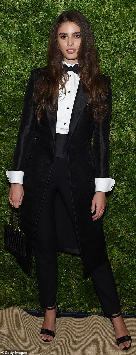 Cross-dressing: Model Taylor Hill tried out an androgynous look with black tuxedo featuring a long jacket and a bow tie