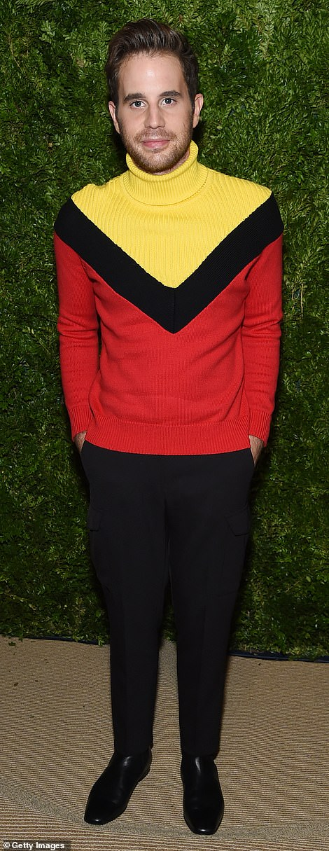 Co-stars: Dear Evan Hansen star Ben Platt added some more color to the evening with a red sweater featuring a thick black 'V' and a canary yellow turtleneck