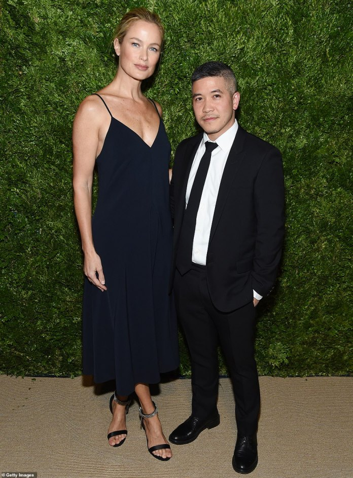 Fashion pals: Carolyn Murphy rocked simple elegance in a plunging midnight blue dress that showcased her fit arms. She posed alongside Thai–American designer Thakoon Panichgul, who had on a classic black suit with a black tie