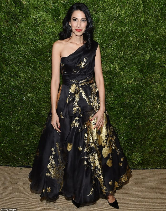 Gold designs: Huma Abedin, former deputy chief of staff to Hillary Clinton, looked lovely in a black gown that exposed one trim svelte shoulder and was decorate with ornate gold designs