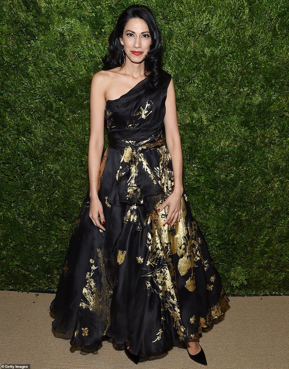 Gold designs:Huma Abedin, former deputy chief of staff to Hillary Clinton, looked lovely in a black gown that exposed one trim svelte shoulder and was decorate with ornate gold designs