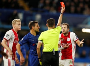 Ajax's Daley Blind is shown a red card by referee Gianluca Rocchi.