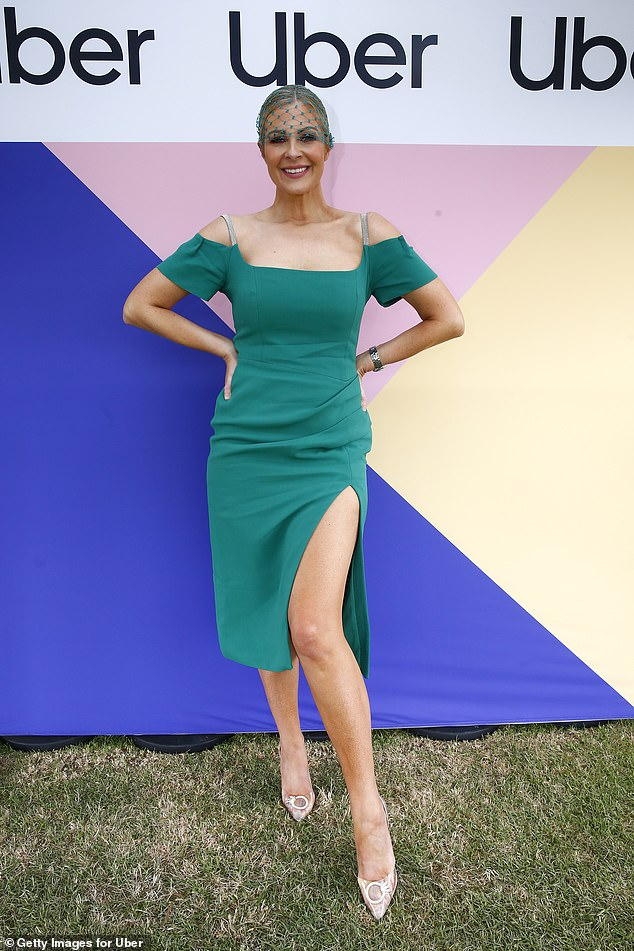 Flaunt it! Lorinska (pictured) looked glamorous as she flaunted her pins in a green off the shoulder dress and stilettos