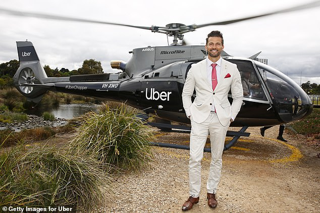 Making a statement: Tim Robards (pictured) dressed to impress in a taupe coloured suit jacket and pant alongside a red tie and square pocket