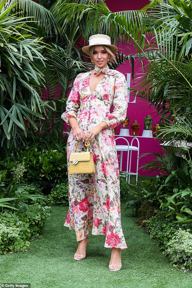 Stunning: Olivia Molly Roger oozed sophistication as she arrived to the event in a long pink and white printed dress
