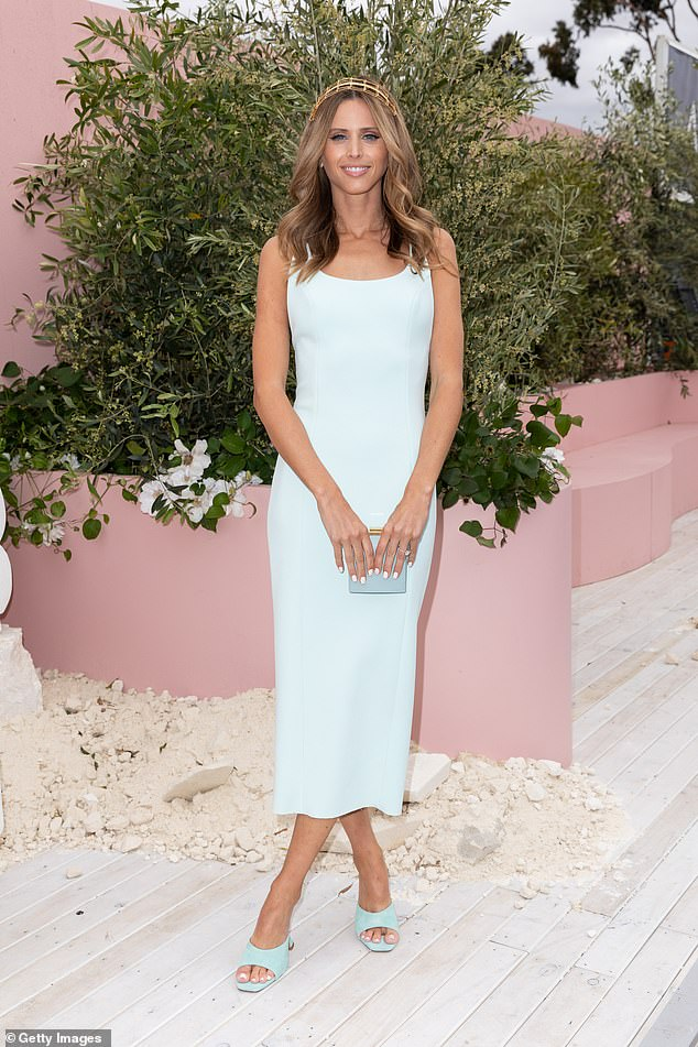 Glowing: WAG Brit Davis (pictured) flaunted her slim physique in a figure-hugging blue dress with matching coloured heels