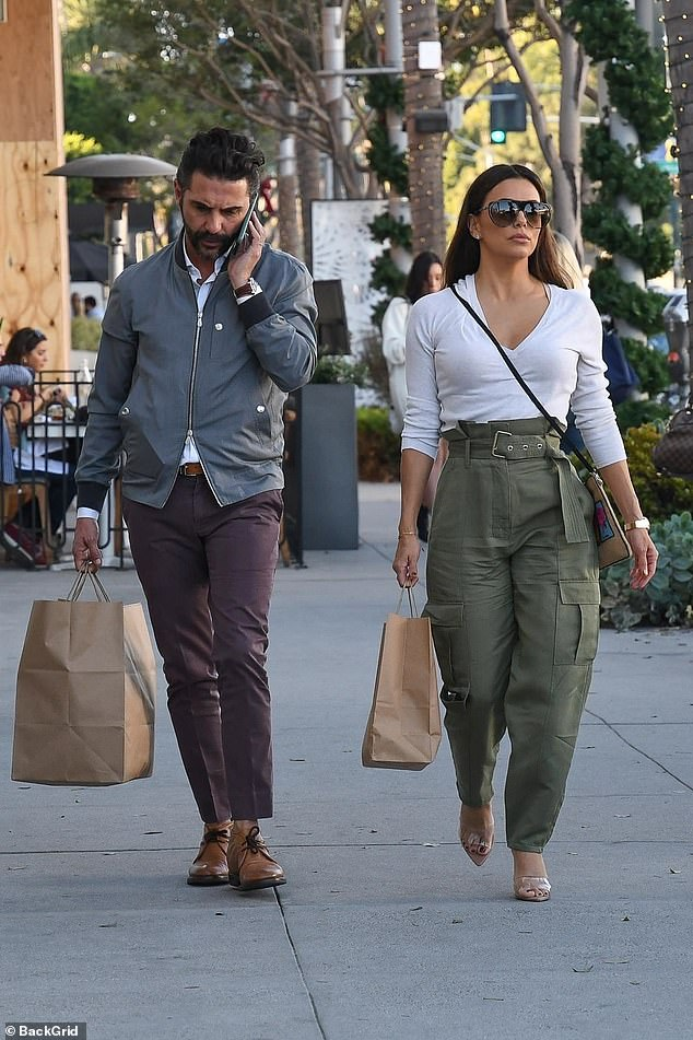 Shopping trip: She was joined by handsome hubby of three years José Bastón for the spot of retail therapy