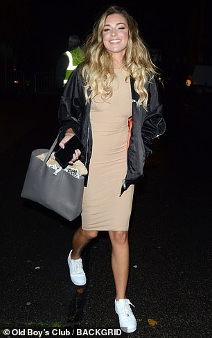 Ensemble: The reality star also sported a pair of white trainers while she styled her blonde tresses into loose waves