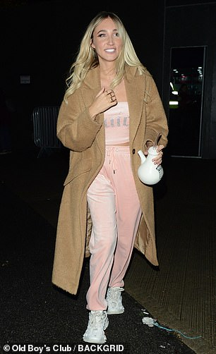 Pretty in pink: Megan McKenna strolled out in a pink velour Juicy tracksuit and tawny overcoat