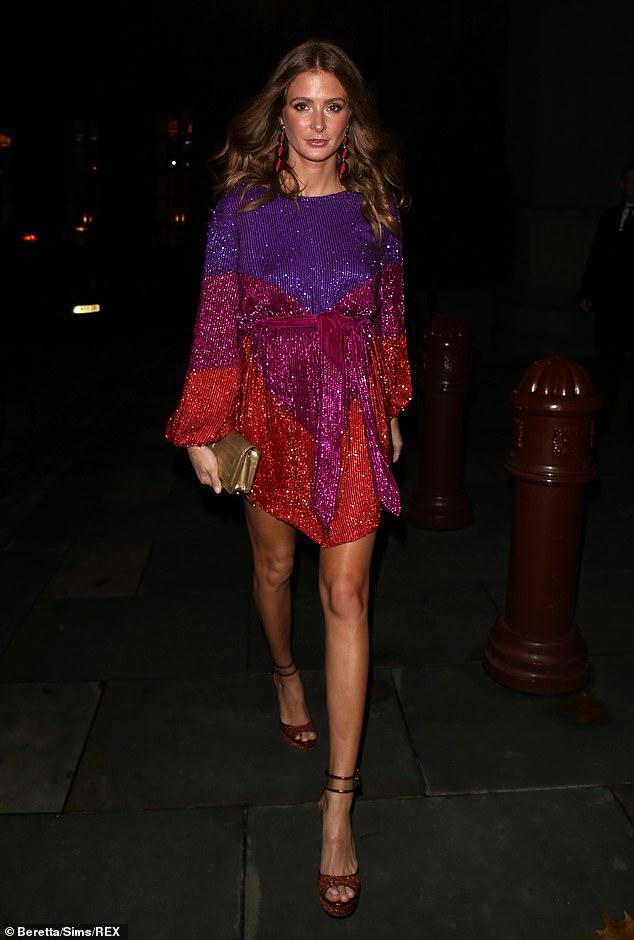 Chic: The reality star looked sensational in the colourful ensemble from Retrofête, which had a ombre design for its purple, pink and red pattern