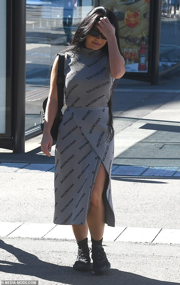Expensive taste! Martha looked stylish at the event, sporting a grey Balenciaga knit dress worth $2100