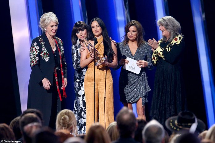 Past and present: Four past winners of Female Vocalist of the Year - Janie Fricke, Pam Tillis, Kathy Mattea and Martina McBride - presented this year's award