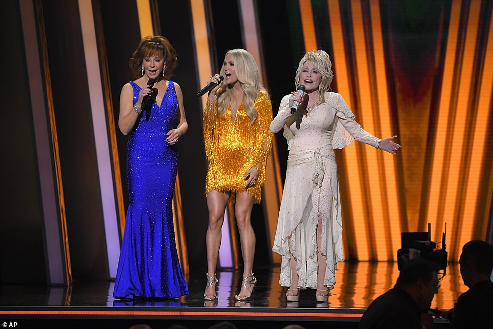 Singing hosts:The show kicked off with hosts Carrie Underwood, Dolly Parton and Reba McIntyre singing a rendition of Those Memories of You, originally performed by Parton, Emmylou Harris and Linda Ronstandt