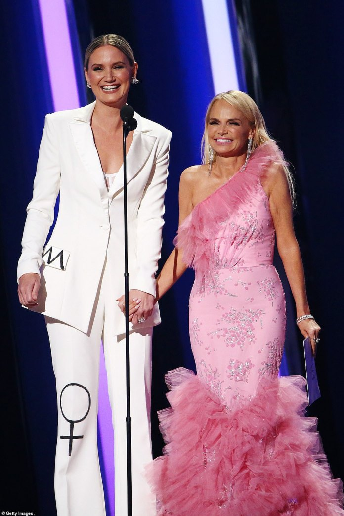 Jokes: Jennifer Nettles and Kristen Chennoweth took the stage to present the Song of the Year Award, as they embraced on stage with some jokes